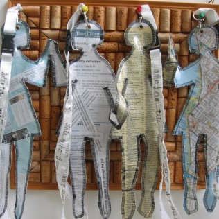 'ID Dolls', 2009, H40xW90cm paper collage, clear vinyl, machine stitched, ribbon, free machine embroidery, machine stitched, metal and plastic hardware.