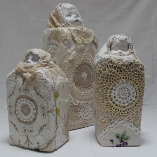 'Immigrant Group', 2011.Recycled fabrics, embroideries and lace doilies, dolls heads, foam, hand and machine stitched.