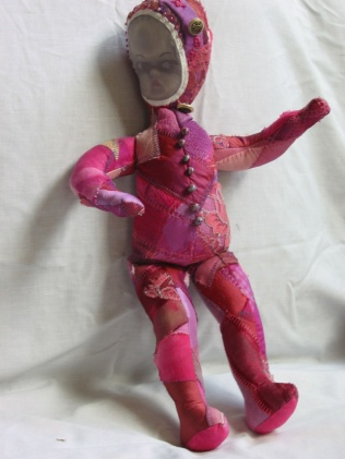 'Pink Doll', 2009, H41xW11xD8cms, Recycled hand dyed silk, lace, cotton, beads, buttons, inkjet print on fabric, hand and machine stitched, polyfibre filling.